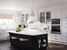 This kitchen features Wilsonart® HD® High Definition® Laminate in Carrara Santorini 1855K-55 glaze finish with AEON™ and a Crescent Decorative Edge.