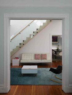 Mork Ulnes, Clayton Street, San Francisco, wood stair up wall of living room