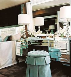 Mirrored vanity table with beautiful aqua blue stool.  I love the sparkle the dual lamps provide.