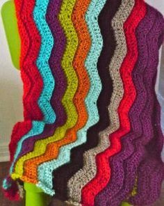 The Simple Rainbow Chevron Crochet Pattern will add a pop of color to any room! | AllFreeCrochetAfghanPatterns.com