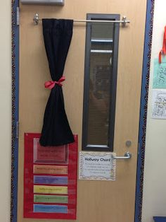 Bishop's Blackboard: A First Grade Blog For safety, it is important to be able to cover the door's window in case of emergency. Since I do not sew, I was trying to think of a way to cover the window quickly. So, here is what I came up with. Using two Command Strips, I hung up an extendable curtain rod with wedge ends. I then used a tier length curtain to hang on it that I purchased at Target. In an emergency, all I have to do is pull the curtain over and untie the ribbon.