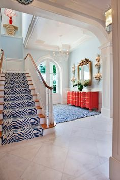Custom wool zebra for client's foyer and staircase.  Seldom Scene Interiors, Private residence - Palm Beach, FL