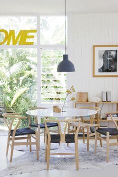 saarinen table with wishbone chairs