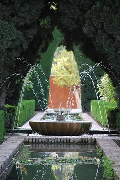 A simple square fountain with water jets in each corner at the Alhambra.