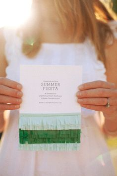 Plain party invite gets a pick-me-up from a touch of crepe paper.