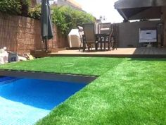 Swimming pool hidden by retractable grass
