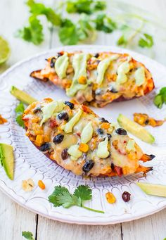 Cheese, Black Beans, and Corn-Stuffed Sweet Potatoes with Avocado Crema