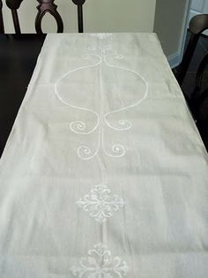 Painted canvas table runner. Such a fabulous idea.