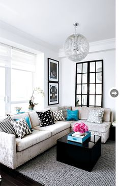 modern living room, love the frames and mirror, black and white scheme