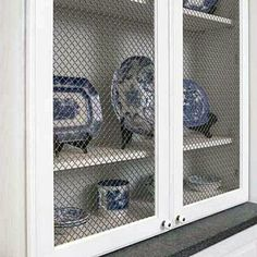 Unique Materials | You can create cabinet door inserts using unique materials like louvered panels, hole caning, patterned tin, or wire grating. | SouthernLiving.com