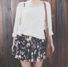 Knotted white shirt over floral skirt