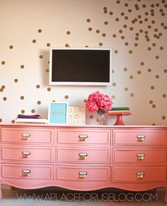 Love the hardware on this repainted dresser.  Also love the confetti wall!