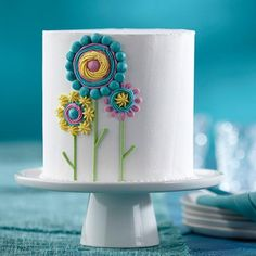 Whimsical flowers give this cake a cute yet creative edge that is perfect for birthday or Mother's Day festivities. Use a variety of tip techniques taught in Wilton Method classes to achieve these beautiful blossoms!