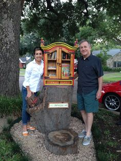 Sheila Bower. Dallas, TX. At the end of a stone path nestled beneath a giant Live Oak tree we created a space for imagination and dreams. This Little Free Library is a repurposed antique curio cabinet painted with bright colors and adorned with whimsical ceramic tiles. Mounted on a large tree stump with a wind chime overhead it whispers a warm and happy memory of our beloved Airedale, Bebop Bower.