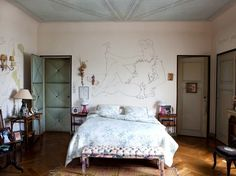 Duck egg blue on ceiling & doors, plus warm orange wood tones in Jean Cocteau's home on the French Riviera