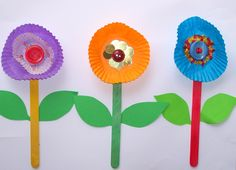flowers made with cupcake liners, buttons, Popsicle sticks