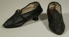 Shoes, 1780-790, England, Leather, Linen. Made from black leather with a brown leather sole and lined with cream linen with a brown leather sock. They are decorated with a black edge binding also to the back and side seams. They are a turnshoe construction.