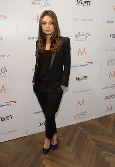 Who can rock a sleek suit better than Mila?