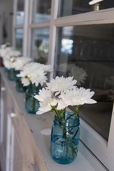 Decorating with blue mason jars and flowers. Coastal, beach style in blue and white, perfect for summer. http://www.songbirdblog.com