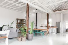 Love this family room/dining room via Mother Mag.