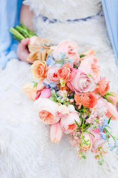 Country bouquet with blue and coral tones