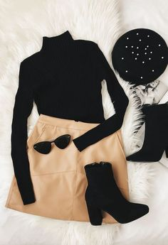 Black turtleneck, camel skirt, black ankle boots