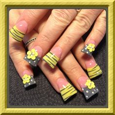 Yikes! Those wide square nails are hideous, but I love the design!!   Grey and yellow 3-d flowers - Nail Art Gallery