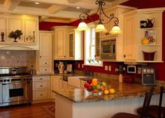 White cabinets; red wall Counter top