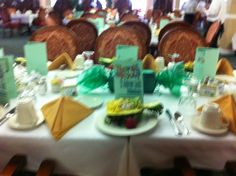 Mint themed Volunteer Appreciation lunch includes oversized mint centerpiece, printed programs, and mint slaw as part of the trio served in the pineapple. Read more at rechargingretirees.blogspot.com