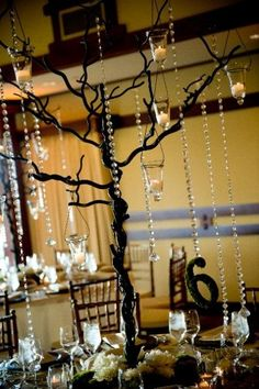 metal tree with crystals and candles centerpiece