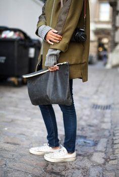 chucks + oversized leather clutch