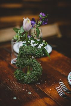 moss table numbers // photo by Chellise Michael // http://ruffledblog.com/elegant-brooklyn-winery-wedding