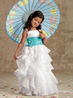 flower girl dress with blue sash and parasol.