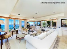 Grand Ocean View Black Point Estate with fresh white interior design and plenty of natural sunlight throughout #decorating #ideas #realestate #living #room