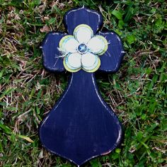 Wooden cross with paint chip flower
