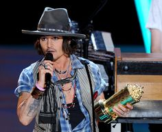 Johnny Depp photographed on stage while accepting the Generation Award at the 2012 MTV Movie Awards in Los Angeles.