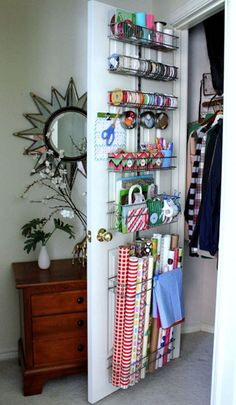 Gift Wrap Organization: Getting your gift wrap organized is easy when you use the door rack system from The Container Store. They have everything you need to create your own custom system. Here are the details on how this system was put together. decor, organizing gift wrapping, gift wrap organization, clean, gift wrapping organization, container store ideas, everything organised, organization ideas, craft rooms