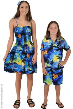 Mother & Son matching hawaiian clothing. Ladies Tube Dress and boys hawaiian shirt. Black & Blue Hibiscus floral print. Sweet set for a cruise, fancy dress, halloween, beach wedding or family vacation. #mothersonmatching #matchymatchy #boyshawaiianshirt #blackwithbluehibiscusleaf #mummyandme #vacation #cruisewear