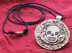 Pirates of the Caribbean - a replica of the Aztec Medallion the young William Turner was wearing when he was rescued from sea.
