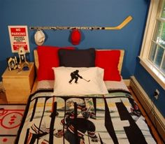 HOckey stick hat rack....have some mini sticks that could be put to use with this!