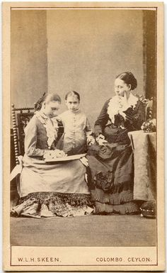 A studio portrait of a young Victorian woman reading a book to her mother and sister. #family #Victorian #1800s