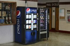 Advertising for Pepsi in the form of a Pepsi vending machine at a Pennsylvania high school. These vending machines are the first thing one sees upon entering the building.
