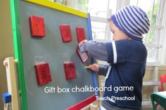 Gift box chalkboard game by Teach Preschool