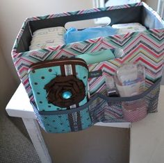 Krissy, I wish I had thought of this!!  Use a fold n file for mobile diaper storage station