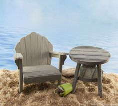 Mini adirondack furniture on the fairy garden beach.