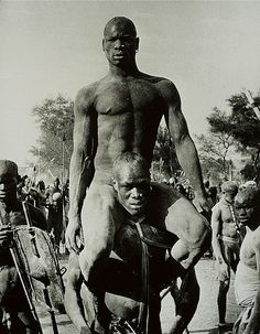 George Rodger - The Champion of a Korongo Nuba Wrestling Match is Carried Shoulder High, Kordofan, Southern Sudan, 1949. S)