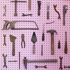 Inexpensive pegboard and paint become instant artwork when paired with a collection of tools. This works great for kitchen gadgets or garden tools. We love the yin and yang of this girly bubblegum shade and rustic hardware.