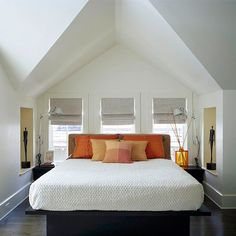 Tucked In  When the shell of a room offers this much drama, furnishings can take a supporting role. This simple bed is beautifully sheltered within a soaring dormer, while well-chosen lamps and accessories stretch into the vertical space.  Why We Love It: The simplicity of the wall color, bedding, and accessories allows for the architecture of the room to shine.
