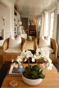 Wicker chairs with white cushions