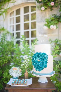 Mini blue topped eclairs and floral cake with gold accents, love! Photography by bubblerock.co.nz  Read more - http://www.stylemepretty.com/2013/08/26/french-chateau-wedding-inspiration-from-bubblerock/